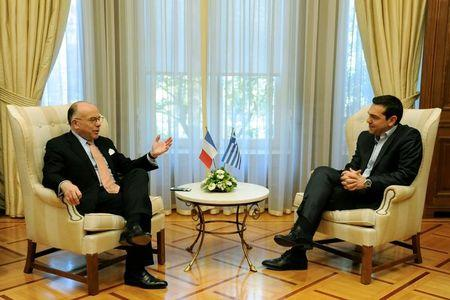 French Prime Minister Cazeneuve meets with his Greek counterpart Tsipras at the Maximos Mansion in Athens