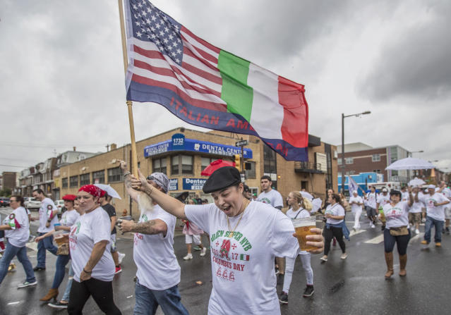 <p>Mari Caraballo, with Golden Slippers Brigade, center, waves her Italian flag as part of the Columbus Day parade on Broad Street in Philadelphia, Pa., on Sunday, Oct. 8, 2017. (Photo: Michael Bryant/The Philadelphia Inquirer via AP) </p>