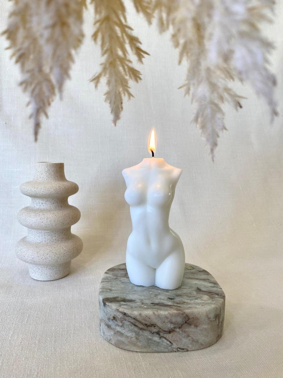 <p>The <span>Female Body Torso Candle</span> ($11, and up) is more of a home decor piece than an actual candle. But, it looks even more gorgeous when burned.</p>