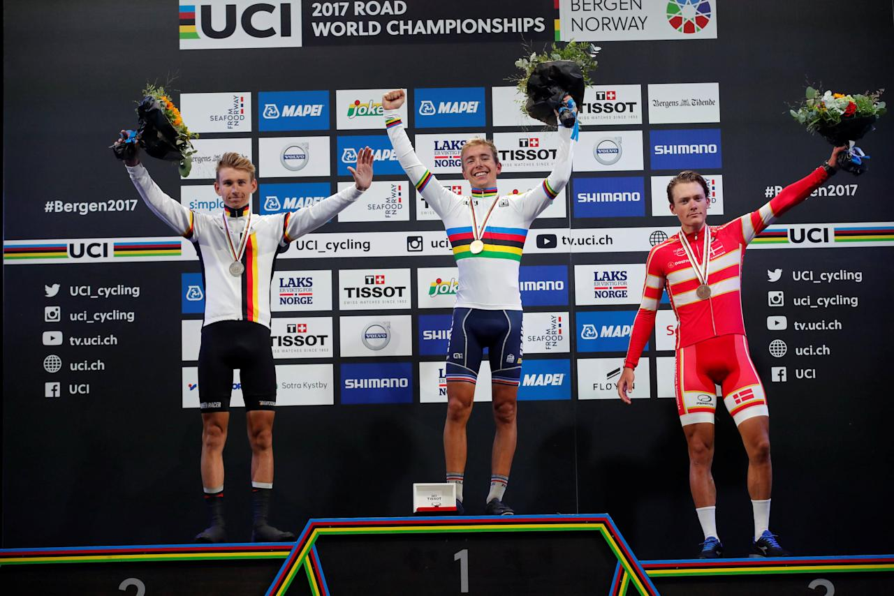 Gold medalist Benoit Cosnefroy of France, flanked by silver medalist Lennard Kamna (L) of Germany and Michael Carbel Svendgaard (R) of Denmark on the podium after UCI Cycling Road World Championships Men Under 23 in Bergen, Norway September 22, 2017. NTB Scanpix/Cornelius Poppe via REUTERS ATTENTION EDITORS - THIS IMAGE WAS PROVIDED BY A THIRD PARTY. NORWAY OUT. NO COMMERCIAL OR EDITORIAL SALES IN NORWAY. NO COMMERCIAL SALES.
