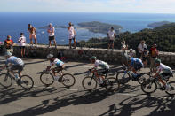 Spectators watch the riders in the Eze pass during the second stage of the Tour de France cycling race over 186 kilometers (115,6 miles) with start and finish in Nice, southern France, Sunday, Aug. 30, 2020. (AP Photo/Thibault Camus)