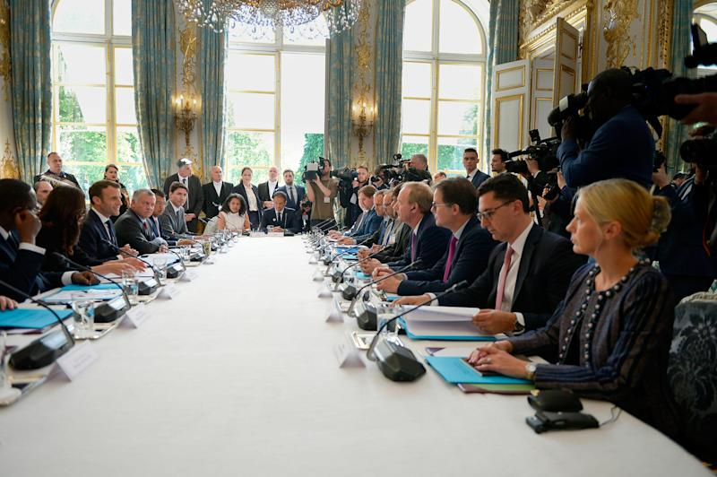 Smith, fourth from bottom right, at a Tech for Good summit with world leaders and top business executives, hosted by French President Emmanuel Macron at the Élysée Palace on May 15 | Isa Harsin—SIPA/AP