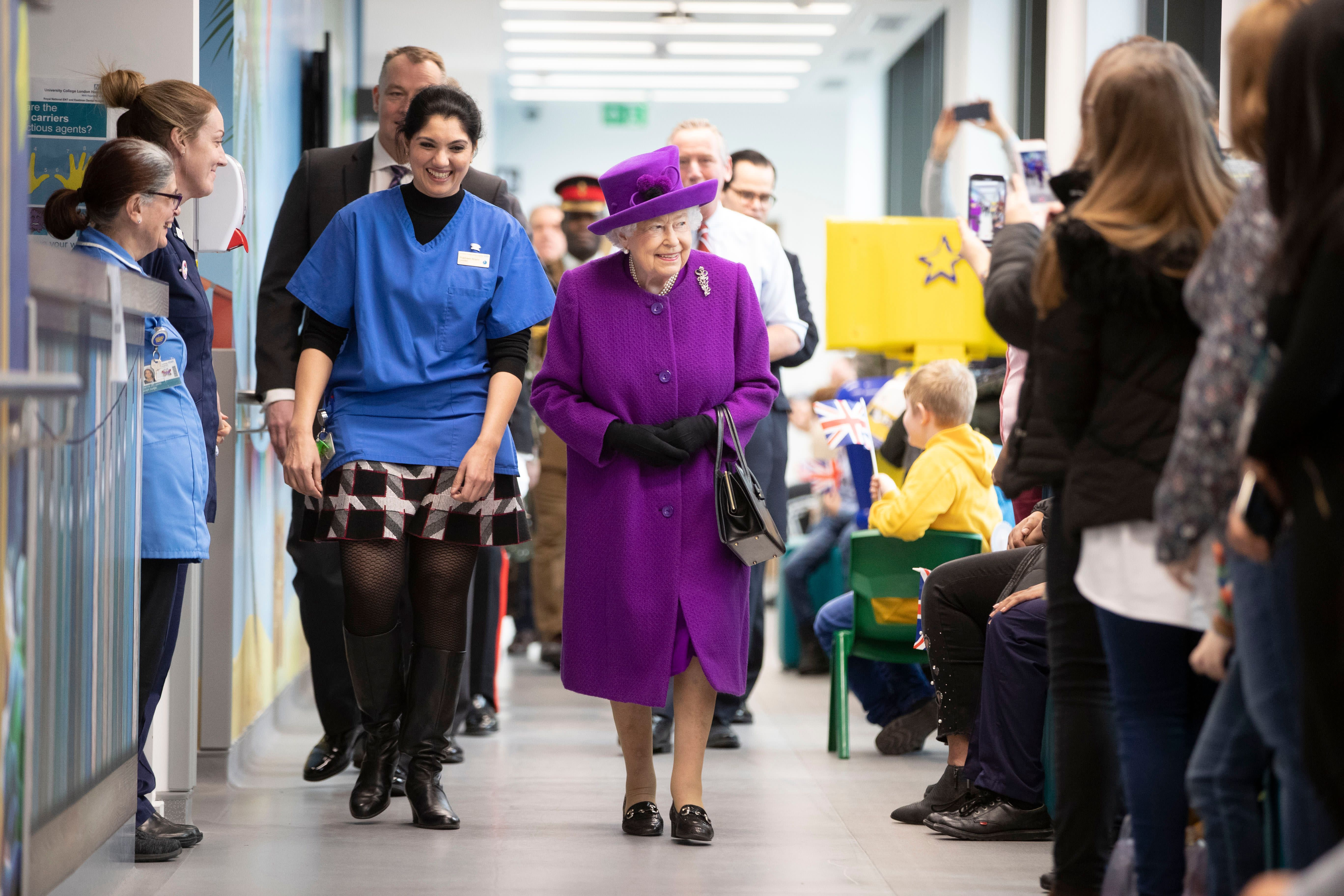 Britain's Queen Elizabeth II gestures during her visit to open the new premises of the Royal National ENT and Eastman Dental Hospital in central London on February 19, 2020. (Photo by Heathcliff O'Malley / POOL / AFP) (Photo by HEATHCLIFF O'MALLEY/POOL/AFP via Getty Images)