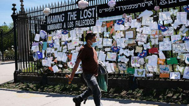 PHOTO: A man walks by a memorial for those who have died from the novel coronavirus outside Green-Wood Cemetery on May 27, 2020, in the Brooklyn borough of New York. (Spencer Platt/Getty Images)