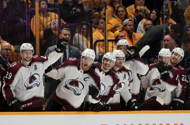 The Colorado Avalanche bench reacts after right wing Sven Andrighetto scored a goal during the third period in Game 5 of an NHL hockey first-round playoff series Friday, April 20, 2018, in Nashville, Tenn. The Avalanche won 2-1. (AP Photo/Sanford Myers)