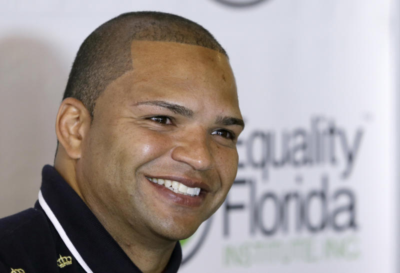 Former Baltimore Ravens reserve linebacker Brendon Ayanbadejo smiles as he talks to reporters during a news conference in Fort Lauderdale, Fla., Tuesday April 23, 2013. An open proponent of gay marriage, Ayanbadejo spoke in favor of it in November, before Maryland passed a law allowing it, and also prior to the Super Bowl. He also recently spoke at a rally on the steps of the Supreme Court. Earlier this month, he told The Baltimore Sun that up to four NFL players may soon come out as gay. (AP Photo/Alan Diaz)