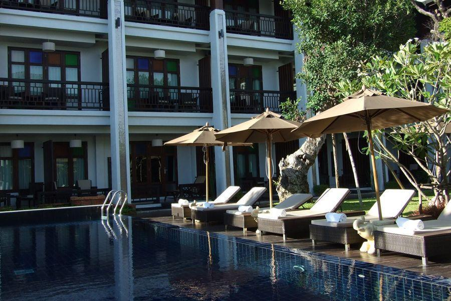 """<p><strong>Where To Stay:</strong> Chiang Mai has a lot of options to suit all budgets. Try the <a href=""""http://www.delannahotel.com/"""" rel=""""nofollow noopener"""" target=""""_blank"""" data-ylk=""""slk:De Lanna Hotel"""" class=""""link rapid-noclick-resp"""">De Lanna Hotel</a>, located in the historic old town district of the city. It's close to the temples and historic sites, as well as the old town square and Three Kings Monument. Rooms go for as low as $65 per night, including breakfast, and there's also a swimming pool.</p><p><strong>Insider Tip:</strong> Serious Eats <a href=""""http://www.seriouseats.com/2014/09/best-khao-soi-chiang-mai-thailand-where-to-eat-thailand-kenji-travel.html"""" rel=""""nofollow noopener"""" target=""""_blank"""" data-ylk=""""slk:recommends"""" class=""""link rapid-noclick-resp"""">recommends</a> chowing down on Northern Thailand's signature egg noodle dish khao soi at Lamduon Fahrm Kaosoi. The restaurant, which has been around for more than 70 years, has two locations (the original is near the old town centre). </p><span class=""""copyright"""">Photo: Courtesy of the De Lanna Hotel.</span>"""