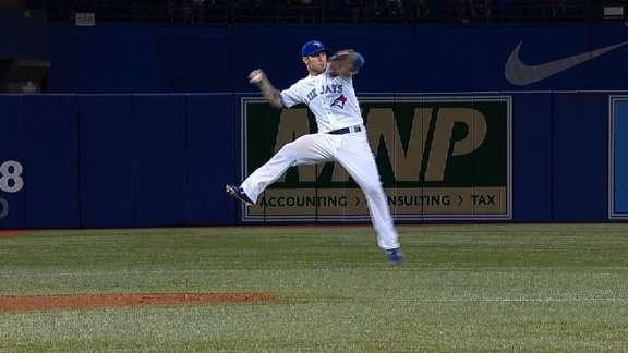 Brett Lawrie adjusts in mid-air to make barehanded play, incredible throw