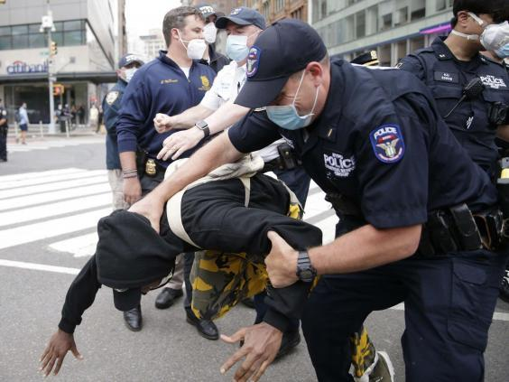 NYPD officers arrested protester following clashes in Union Square (Alamy Live News)