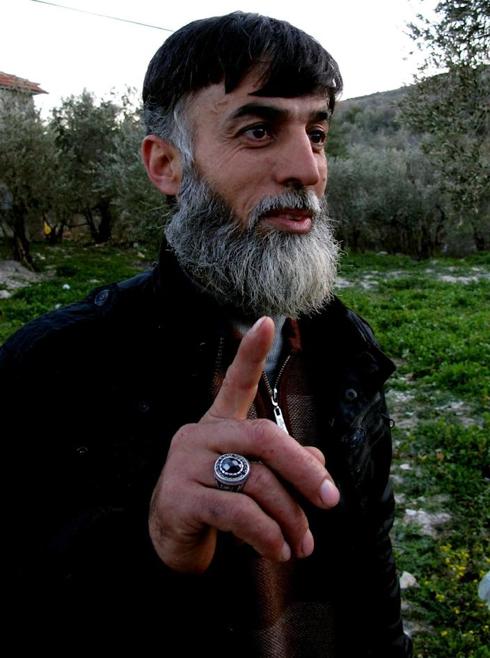 A Syrian rebel commander, Abdel-Salam Delul Feyzo, gestures during an interview with The Associated Press in the border village of Gorentas in Hatay province, Turkey, Monday, March 19, 2012. Rebels seeking to oust President Bashar Assad lack weapons to seriously challenge his professional army and say it is getting even harder to bring in supplies for rebel fighters. This could make it easier for Assad's regime _ which freely buys advanced weapons from Russia and others _ to crush its opponents. (AP Photo/Selcan Hacaoglu)