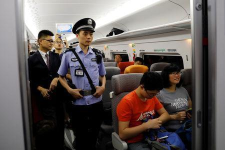 A Chinese policeman patrols a train during the first day of service of the Hong Kong Section of the Guangzhou-Shenzhen-Hong Kong Express Rail Link, in Hong Kong, China September 23, 2018. REUTERS/Tyrone Siu