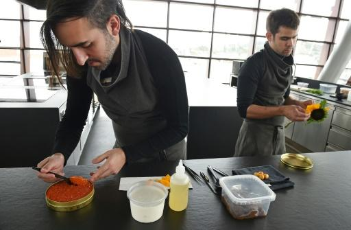 Chef Jordan Kahn (L) prepares a dish at his restaurant Vespertine
