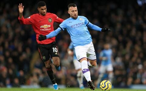 Marcus Rashford of Man Utd battles with Nicolas Otamendi of Man City during the Premier League match between Manchester City and Manchester United at the Etihad Stadium on December 7, 2019 in Manchester, United Kingdom - Credit: Offside