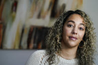 Dani Ayers CEO of the #MeToo movement poses for a portrait in her home in Atlanta on Tuesday, Oct. 13, 2020. Ayers quietly yet with a bold vision transitioned into becoming the movement's CEO in July after first joining the organization in 2018. (AP Photo/John Bazemore)