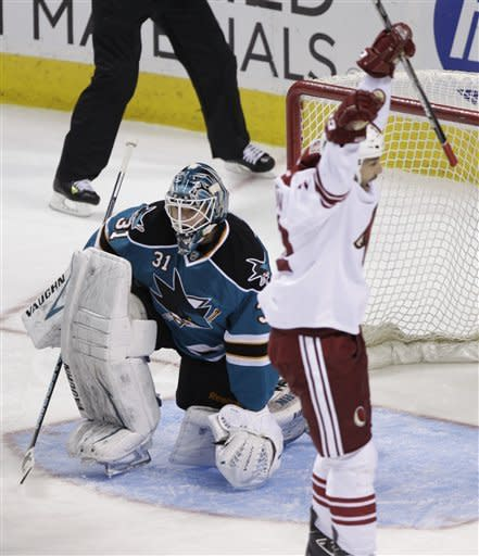 Phoenix Coyotes center Daymond Langkow (22) celebrates after scoring past San Jose Sharks goalie Antti Niemi (31), of Finland, in the first period of an NHL hockey game in San Jose, Calif., Saturday, March 24, 2012. (AP Photo/Paul Sakuma)