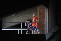 Three Illinois football fans head to their seats before an NCAA college football game between Illinois and Nebraska Saturday, Aug. 28, 2021, in Champaign, Ill. Fans headed back into stadiums this weekend and, along with binoculars, sunscreen and other essentials, many will be packing face masks. (AP Photo/Charles Rex Arbogast)