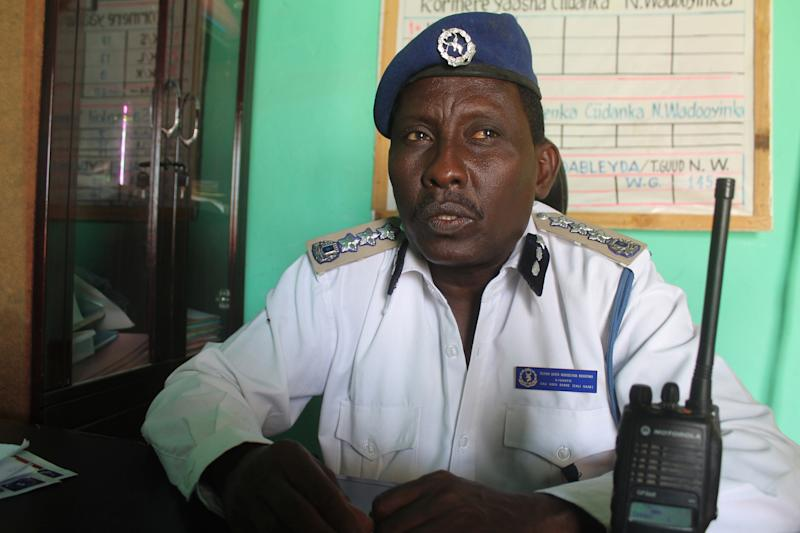 """In this photo taken, Wednesday, Dec, 4, 2013.Somalia's traffic police Chief Gen. Ali Hersi Barre speaks during an interview with The Associated Press at his office in Mogadishu, Somalia. Mogadishu in recent months has started to install road signs for the first time after decades of lawlessness left a culture of """"anything goes"""" on the road. Large parts of the country's residents are unfamiliar with traffic laws, increasing the pressure on traffic police struggling to impose law and order in a dangerous and chaotic city. (AP Photo/Farah Abdi Warsameh)"""