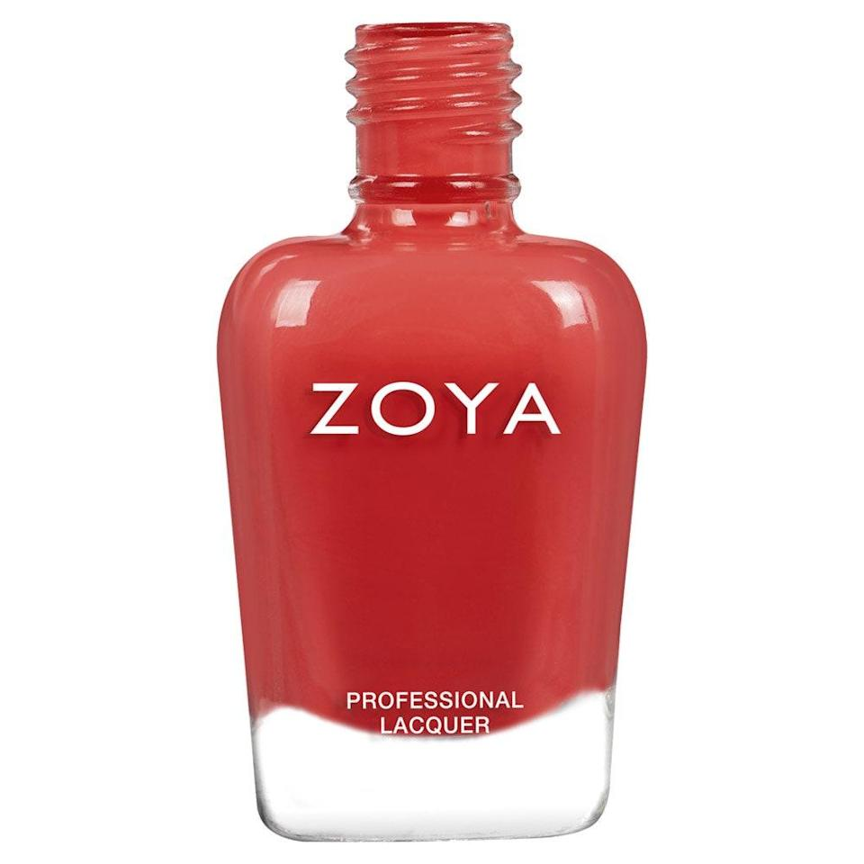 """Nail polish brands never cease to amaze us with their ability to reinvent coral over and over. Desi, one of the latest shades by Zoya, is a contender for our all-time favorite take on the color because it adds a spicy redness to the usual balance of pink and orange. The brand calls it a """"vibrant geranium coral cream,"""" and we wouldn't dare argue with such a spot-on description."""