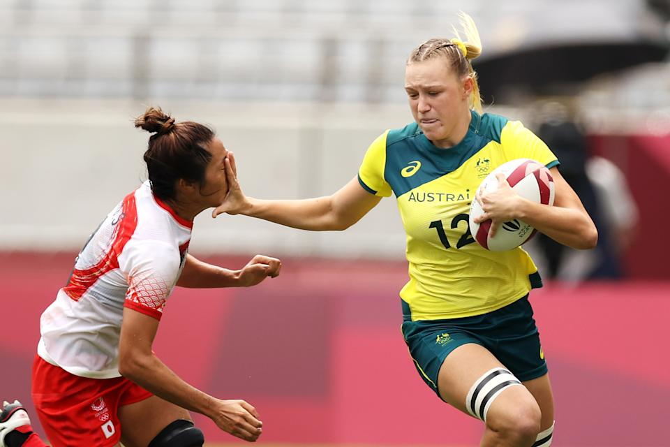 <p>Maddison Levi of Team Australia fends away Miyu Shirako of Team Japan on her way to score a try in the Women's pool C match between Team Australia and Team Japan during the Rugby Sevens on day six of the Tokyo 2020 Olympic Games at Tokyo Stadium on July 29, 2021 in Chofu, Tokyo, Japan. (Photo by Dan Mullan/Getty Images)</p>