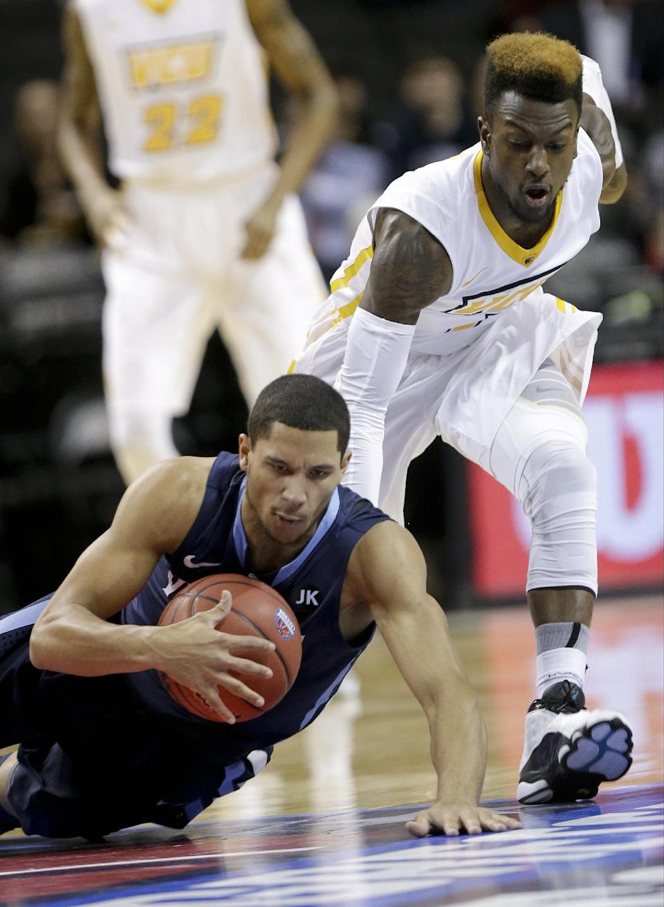 Villanova's Josh Hart, left, loses control of the ball as Virginia Commonwealth's JeQuan Lewis, right, defends during the first half of an NCAA college basketball game Monday, Nov. 24, 2014, in New York. (AP Photo/Frank Franklin II)