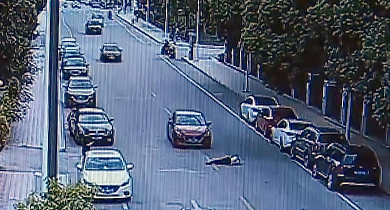 The footage shows the woman slamming on the brakes and throwing her persistent husband off, leaving him lying injured on the ground as she reverses away.