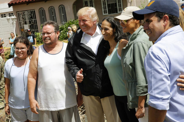 <p>President Donald Trump and first lady Melania Trump pose with residents while surveying hurricane damage in San Juan, Puerto Rico, Oct. 3, 2017. (Photo: Jonathan Ernst/Reuters) </p>