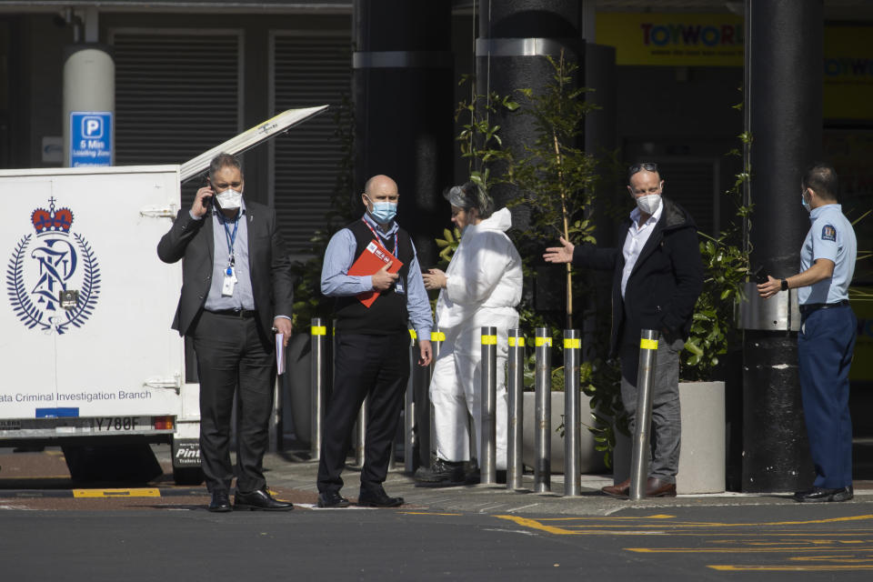 Police and forensic staff stand outside a supermarket in Auckland, New Zealand, Saturday, Sept. 4, 2021.New Zealand authorities say they shot and killed a violent extremist, Friday, Sept. 3 after he entered the supermarket and stabbed and injured six shoppers. Prime Minister Jacinda Ardern described Friday's incident as a terror attack. (AP Photo/Brett Phibbs)