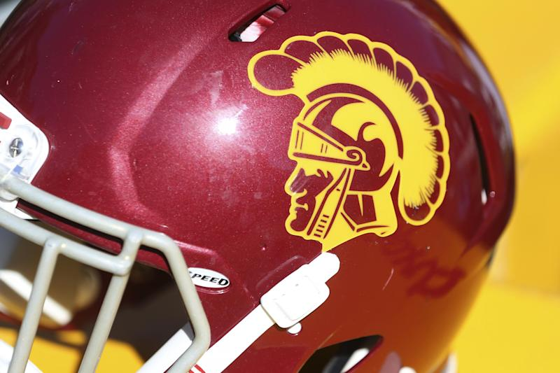 A USC helmet sits on the bench in the second half, during a game against BYU at an NCAA college football game, Saturday, Sept. 14, 2019, in Provo, Utah. (AP Photo/George Frey)