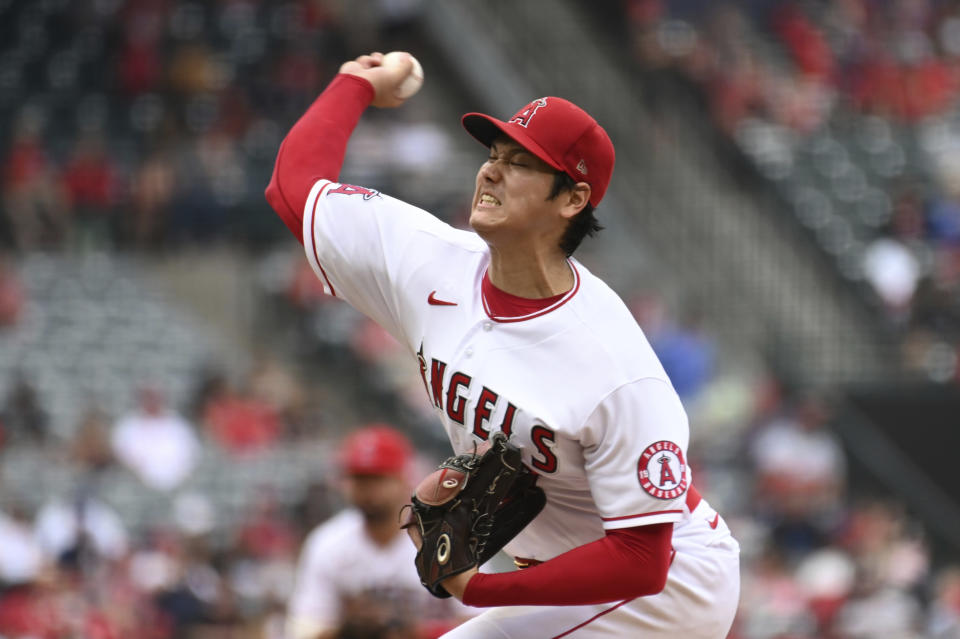 Los Angeles Angels pitcher Shohei Ohtani throws to home plate during the fifth inning of a baseball game against the Seattle Mariners, Sunday, Sept. 26, 2021, in Anaheim, Calif. The Mariners won 5-1. (AP Photo/Michael Owen Baker)