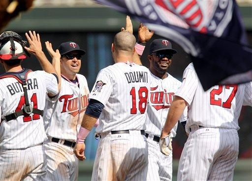 Minnesota Twins players, from left to right, Drew Butera, Brian Dozier, Ryan Doumit, Denard Span and Chris Parmelee celebrate after defeating the Toronto Blue Jays 4-3 in a baseball game on Sunday, May 13, 2012, in Minneapolis. (AP Photo/Genevieve Ross)