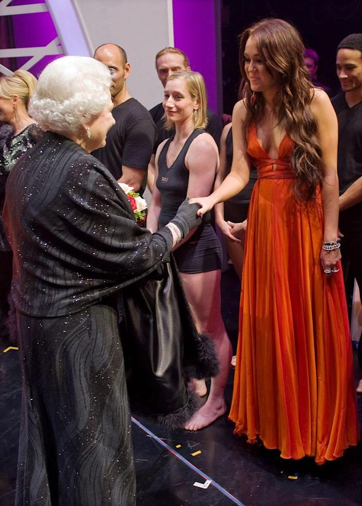 <p>I'm not sure what Queen Elizabeth would think of Miley's fashion choices today, but back in 2009, she seemed to approve of the star's burnt orange gown. </p>