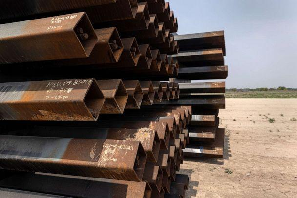 PHOTO: Unused pieces of steel bollard-style wall lay near a portion of unfinished border wall at the U.S.-Mexico border, April 14, 2021, in La Joya, Texas. (John Moore/Getty Images)