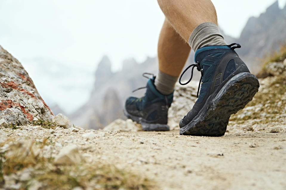 Looking for a gift that the man will love in your life? You can't go wrong with hiking shoes. (Photo: Getty Images)