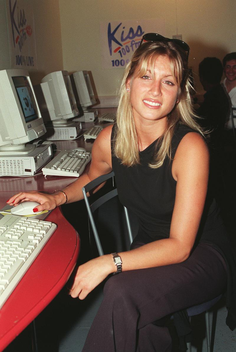 "PA NEWS PHOTO 3/9/98 TV & RADIO PRESENTER DANI BEHR AT THE LAUNCH OF THE ""KISS 100 WEBSITE"" AT THE CYBERIA CYBERCAFE IN LONDON."