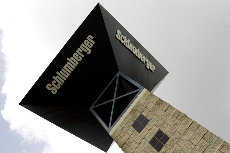 FILE - In this Oct. 18, 2007 file photo, a sign tower reaches toward the sky at the entrance to Schlumberger's Sugar Land, Texas campus. Schlumberger Ltd. said Friday, Jan. 22, 2010, oil drilling has started to recover after a plunge in crude prices last year helped cut the company's fourth-quarter profit by 31 percent.(AP Photo/Pat Sullivan, file)