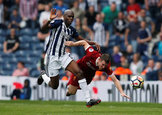 """Soccer Football - Premier League - West Bromwich Albion v Liverpool - The Hawthorns, West Bromwich, Britain - April 21, 2018 West Bromwich Albion's Allan Nyom in action with Liverpool's James Milner REUTERS/Andrew Yates EDITORIAL USE ONLY. No use with unauthorized audio, video, data, fixture lists, club/league logos or """"live"""" services. Online in-match use limited to 75 images, no video emulation. No use in betting, games or single club/league/player publications. Please contact your account representative for further details."""