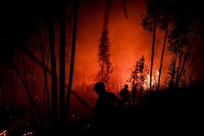 Firefighters tackle a wildfire at Amendoa in Macao, central Portugal on July 21, 2019. (Photo: Patricia De Melo Moreira/AFP/Getty Images)