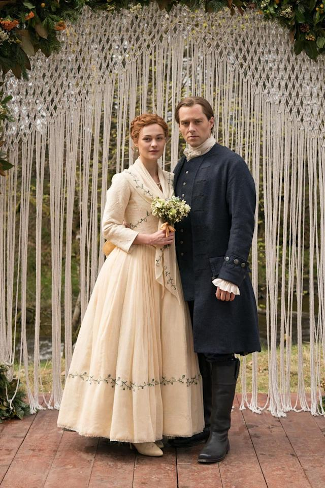 "<p>Bree's dress looks simple at first glance, but the beautiful embroidered cream gown is chock full o' references. </p><p>""We make a point of showing that this is <a href=""https://www.oprahmag.com/entertainment/tv-movies/g27562323/outlander-cast-in-real-life/?slide=11"" target=""_blank"">one of Jocasta</a>'s dresses that has been reconfigured for the wedding,"" Skelton told <em><a href=""https://www.vogue.com/slideshow/outlander-season-5-episode-1-brianna-roger-wedding-photos"" target=""_blank"">Vogue</a>, </em>who first revealed the photos<em></em>. ""It's a hand-me-down, which is quite sweet.""</p><p>""We tried to get a little bit of the '60s and '70s vibe in there, too. It's not your conventional wedding dress,"" Skelton said. ""There's the fichu [collar], which we often wear when we have a corset on in the past. And then later for the dancing and party time, that comes off, and it feels a little bit more free.""</p>"