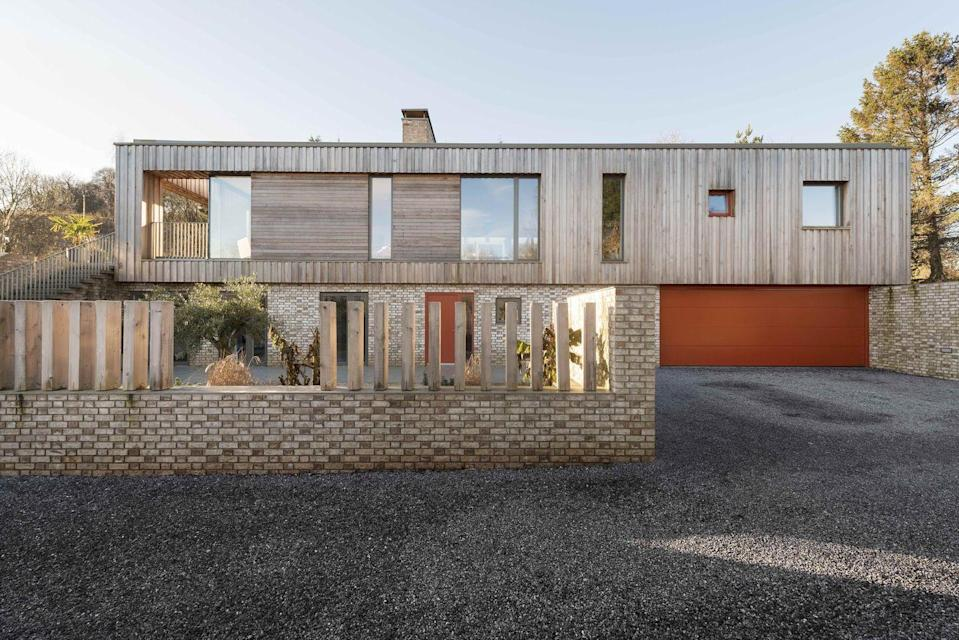 """<p>Architects Jackie Gillespie and Phil Yunnie pride themselves on their diverse portfolio. Whether working on eye-catching new-builds such as Jackmans House (pictured), withits glazed 'cactus house', or renovating historic properties like Balfour Manor, their studio has a knack for mixing old and new styles.</p><p><strong>They say </strong>'We like to approach every project with an open mind. We try to avoid a house style and enjoy the freedom to try new ideas and technologies where appropriate.' <a href=""""https://gyarchitects.co.uk/"""" rel=""""nofollow noopener"""" target=""""_blank"""" data-ylk=""""slk:gyarchitects.co.uk"""" class=""""link rapid-noclick-resp"""">gyarchitects.co.uk</a></p>"""