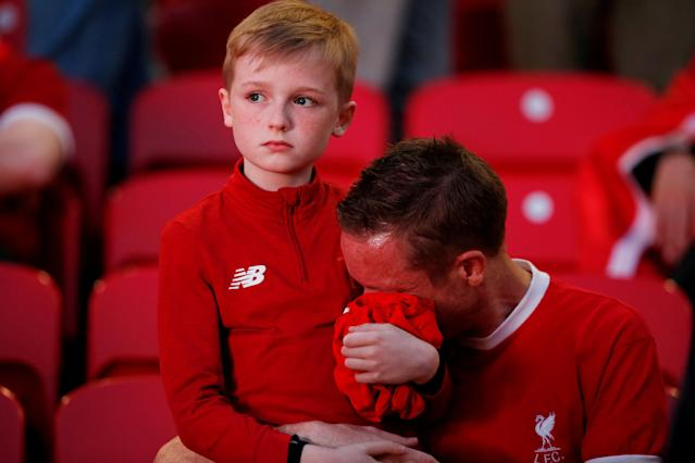 Soccer Football - Liverpool fans watch the Champions League Final - Liverpool, Britain - May 26, 2018 Liverpool fans react inside Anfield REUTERS/Andrew Yates TPX IMAGES OF THE DAY