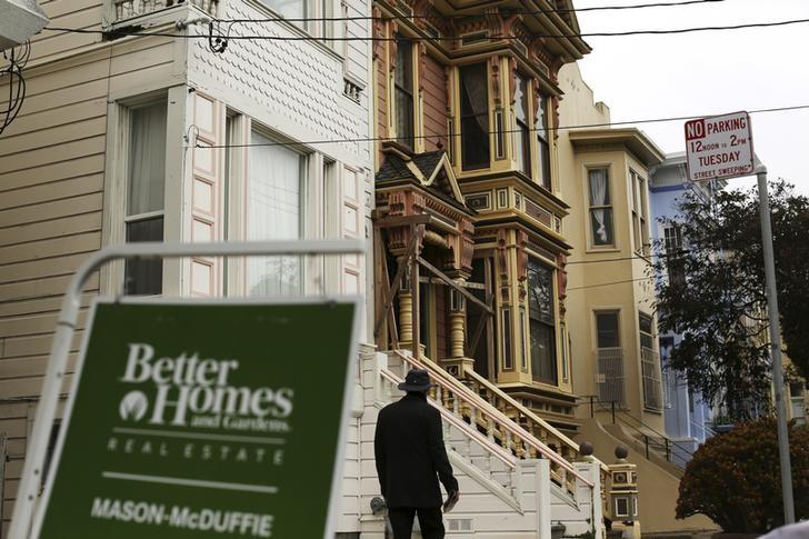 A real state sign is seen near a row of homes in the Haight Ashbury neighborhood in San Francisco