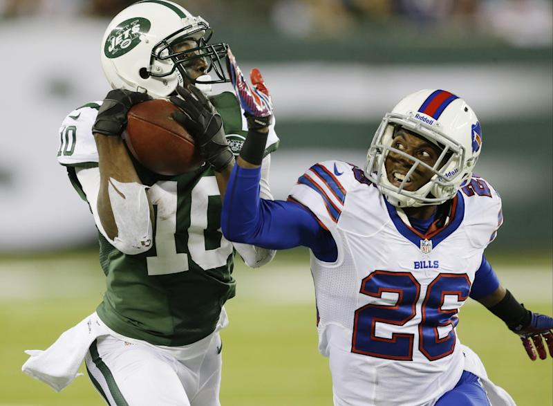 New York Jets' Santonio Holmes (10) catches a pass for a touchdown as Buffalo Bills defensive back Justin Rogers (26) defendsn during the second half of an NFL football game Sunday, Sept. 22, 2013, in East Rutherford, N.J. (AP Photo/Seth Wenig)