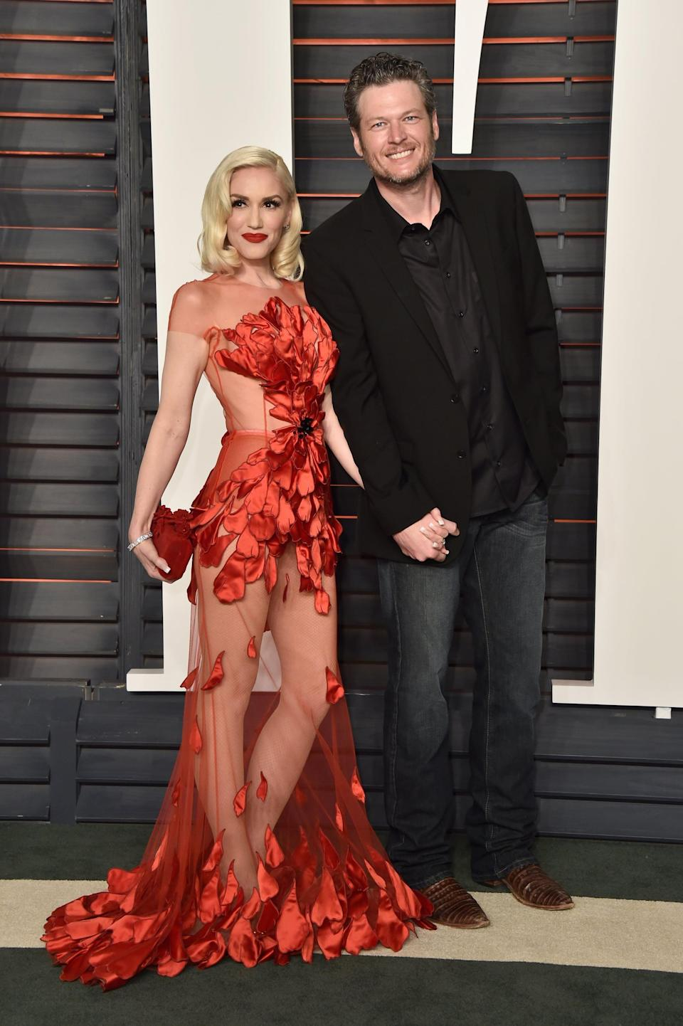 """<p>Attending the 2016 <strong>Vanity Fair</strong> Oscars afterparty wearing <a href=""""https://www.popsugar.com/fashion/photo-gallery/40320806/image/40378793/Gwen-Stefani"""" class=""""link rapid-noclick-resp"""" rel=""""nofollow noopener"""" target=""""_blank"""" data-ylk=""""slk:a sheer red gown"""">a sheer red gown</a> by Yanina Couture.</p>"""