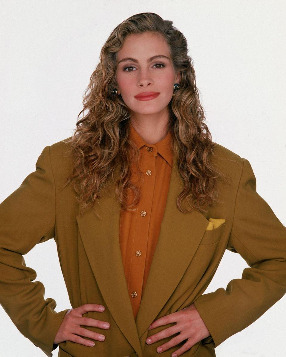 <p>Continuing the trend of heavy product use, Julia Roberts and other celebs gelled their curls for a slick-down style.</p>
