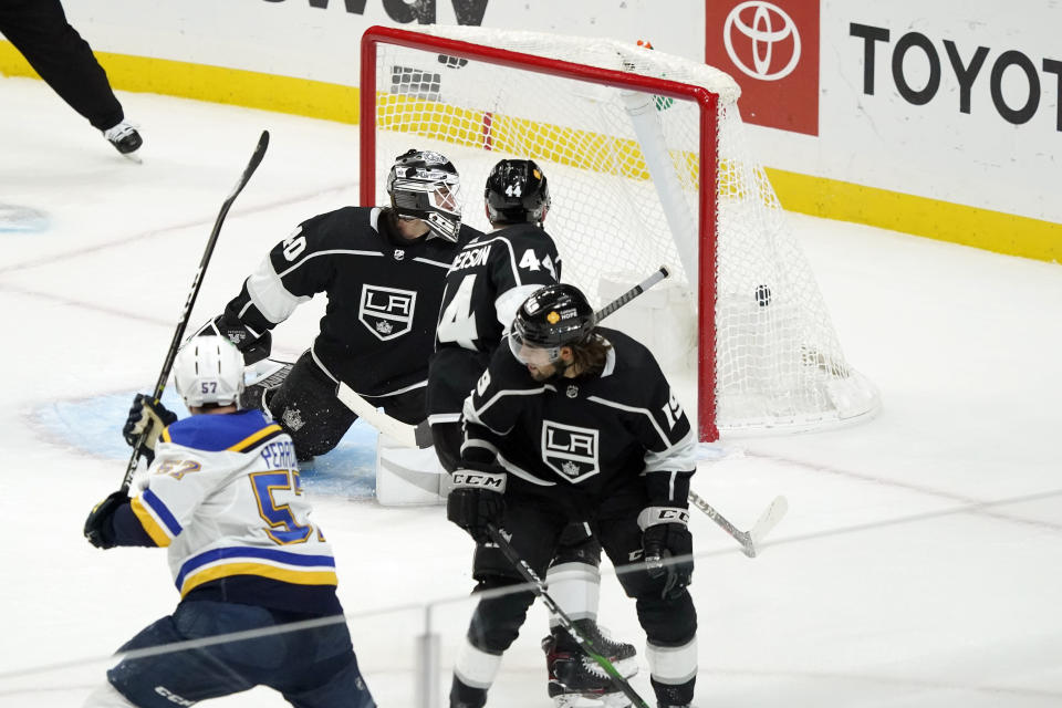 St. Louis Blues left wing David Perron, bottom left, scores past Los Angeles Kings goaltender Calvin Petersen, top left, during the third period of an NHL hockey game Friday, March 5, 2021, in Los Angeles. (AP Photo/Marcio Jose Sanchez)