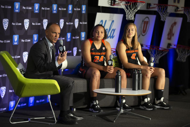 Oregon State head coach Scott Rueck, from left, along with players Destiny Slocum and Mikayla Pivec, speaks to reporters during the Pac-12 Conference women's NCAA college basketball media day, Monday, Oct. 7, 2019, in San Francisco. (AP Photo/D. Ross Cameron)