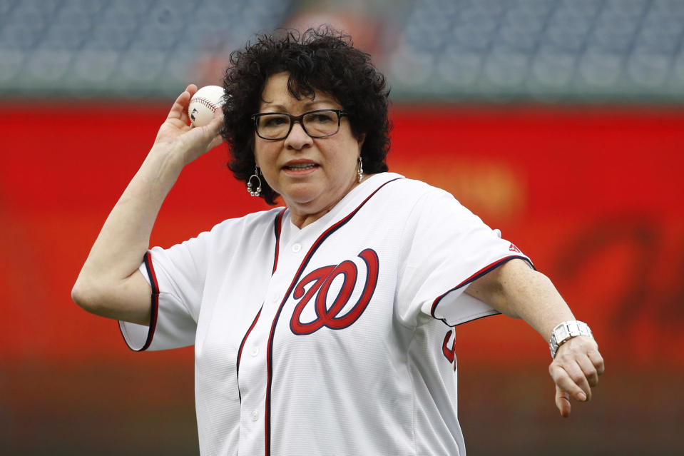 Supreme Court Associate Justice Sonia Sotomayor throws out a ceremonial first pitch before a baseball game between the Philadelphia Phillies and the Washington Nationals, Thursday, Sept. 26, 2019, in Washington. (AP Photo/Patrick Semansky)