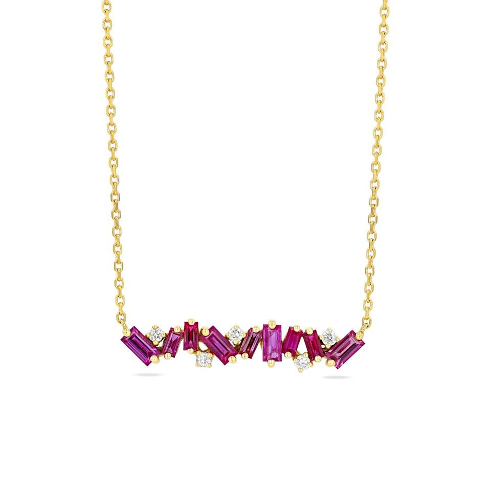 """<p><a class=""""link rapid-noclick-resp"""" href=""""https://suzannekalan.com/products/ruby-fireworks-bar-necklace-2?_pos=1&_sid=04d528733&_ss=r"""" rel=""""nofollow noopener"""" target=""""_blank"""" data-ylk=""""slk:SHOP NOW"""">SHOP NOW</a></p><p>Setting its dainty ruby baguettes and diamonds at angles to each other gives Suzanne Kalan's necklace a feeling of energy and movement. </p><p>Ruby, diamond and yellow gold necklace, from £1,099.41, <a href=""""https://suzannekalan.com/"""" rel=""""nofollow noopener"""" target=""""_blank"""" data-ylk=""""slk:Suzanne Kalan"""" class=""""link rapid-noclick-resp"""">Suzanne Kalan</a></p>"""