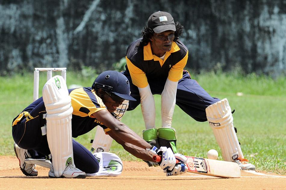 A visually impaired Sri Lankan Army soldier (left) plays a shot during a cricket match in Colombo on September 27, 2013. Nearly 30,000 government troops were injured and 6,200 killed during the last three years of Sri Lanka's 37-year war with the separatist Tamil Tigers that ended May 2009. AFP PHOTO/ Ishara S. KODIKARA
