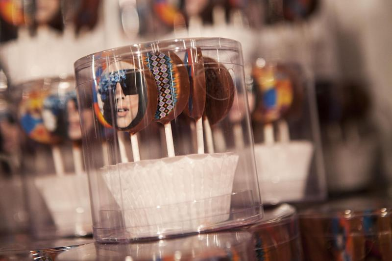 Candy, including some with a likeness of Lady Gaga on them, are displayed at Gaga's Workshop, a collaborative fashion and lifestyle project between Lady Gaga and Barney's New York, at the Barney's store on East 60th Street in New York on Monday, Nov. 21, 2011. (AP Photo/Andrew Burton)